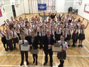 Cambuslang schools worked together to win a 'Champions for Change' award and were acknowledged in the Scottish Parliament