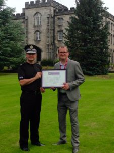 NBM Campaign Director Dave Scott presenting the award to Lanarkshire Division Chief Superintendent Roddy Irvine at the National Police Training College